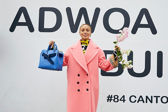 180508_Adwoa-Aboah-in-a-coral-wool-cashmere-cocoon-coat-and-carrying-The-small-Belt-Bag-c-Courtesy-of-Burberry_Juergen-Teller.jpg